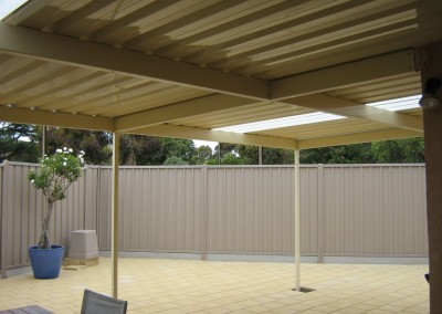 Classic Cream flat roof verandah with Paperbark Colorbond Good Neighbour fencing Merino