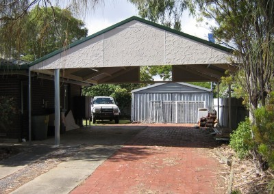 Gable roof carport, 25 degree pitch, Stucco gable ends, Cottage green flashing, under construction Reynella